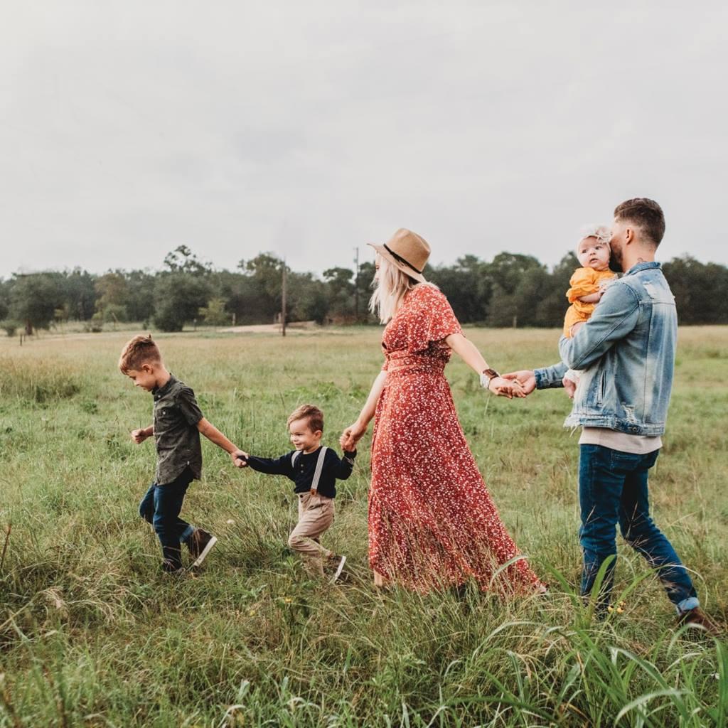 Family running through field